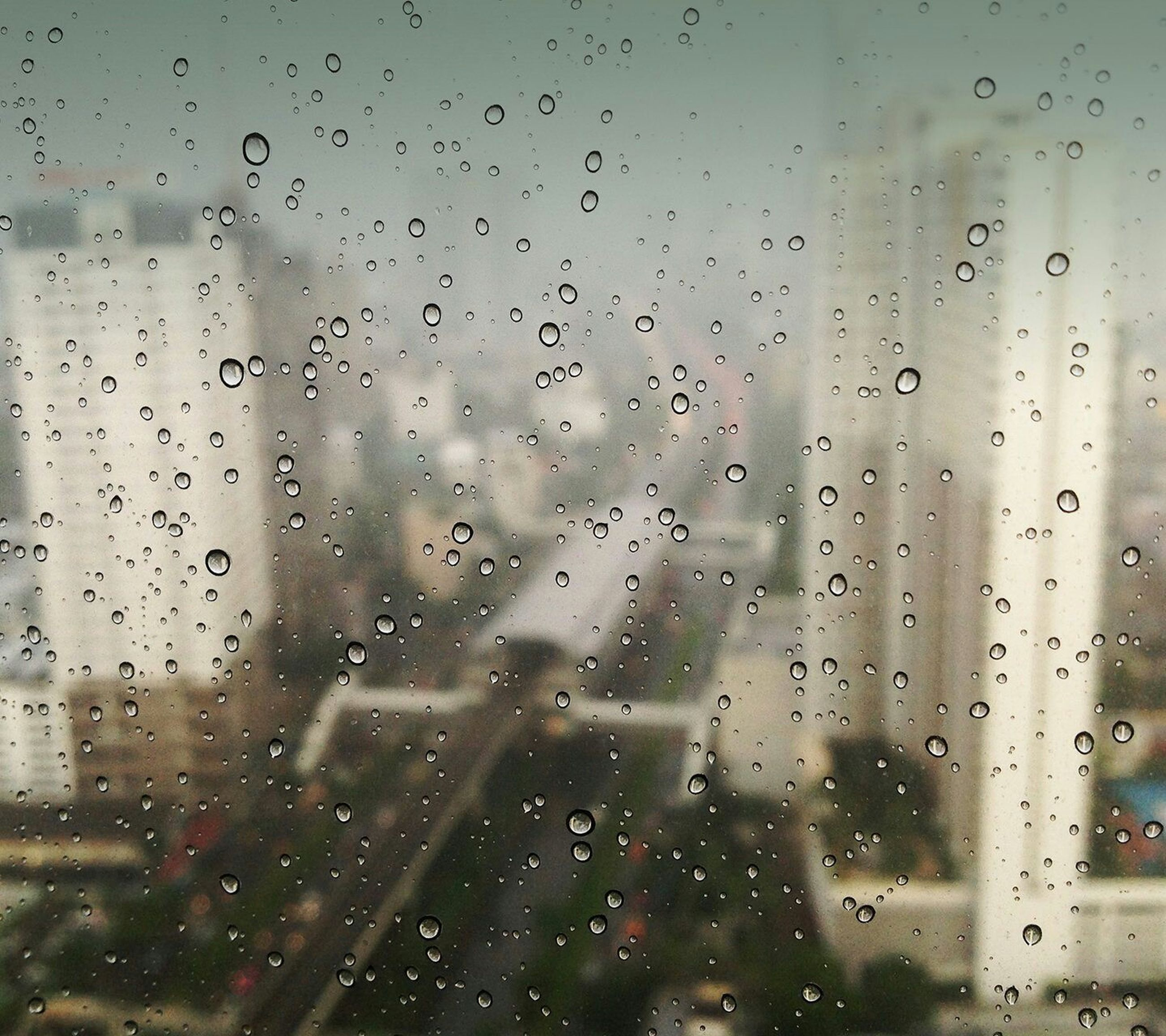 drop, wet, window, indoors, rain, transparent, glass - material, weather, raindrop, water, transportation, full frame, season, backgrounds, glass, vehicle interior, mode of transport, focus on foreground, car, monsoon
