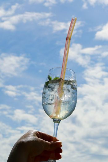 Low Angle View Sky Cloud Cloud - Sky Outdoors Drinks With Friends Transparent Glass Ice Cube Drinking Glass Drink Refreshment Cold Drink Iced Drink Hugo Drinks Delicious Refreshingdrink Drinking Straw Icecold Deliciousness Enjoying A Drink  Cold Drinks Raise Your Glass Cheers