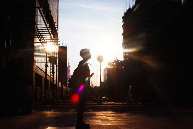 Architecture Backlit Subject Full Length Leisure Activity Lifestyles Lost In The City Silhouette Street Street Light Sun Sunbeam Sunlight Walking