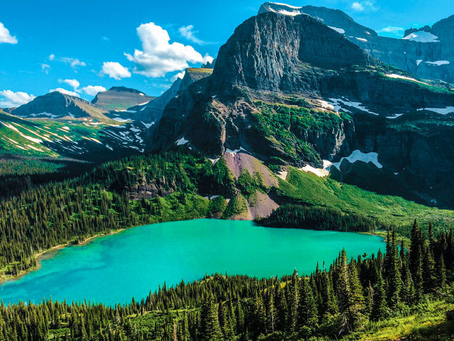 Grinnell Lake, Montana Adventure Alpine Beauty In Nature Cloud - Sky Day Emerald Environment Green Hiking Horizontal Lake Landscape Mountain Mountain Range Nature No People Outdoors Pristine Reflection Scenics Sky Snow Tourism Travel Destinations Water