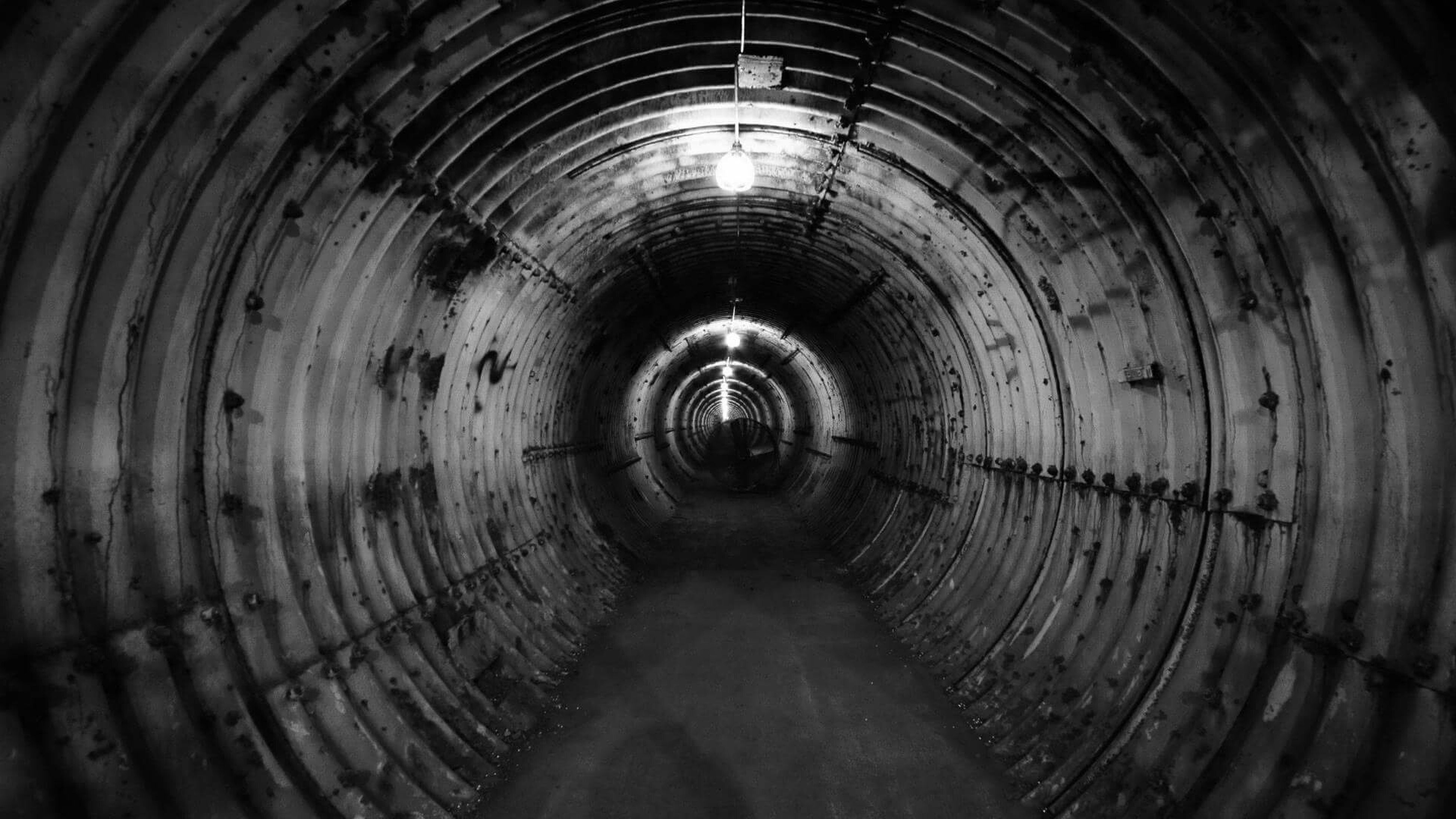 indoors, tunnel, diminishing perspective, the way forward, ceiling, vanishing point, arch, full frame, circle, pattern, backgrounds, no people, old, interior, close-up, hole, illuminated, textured, day, empty