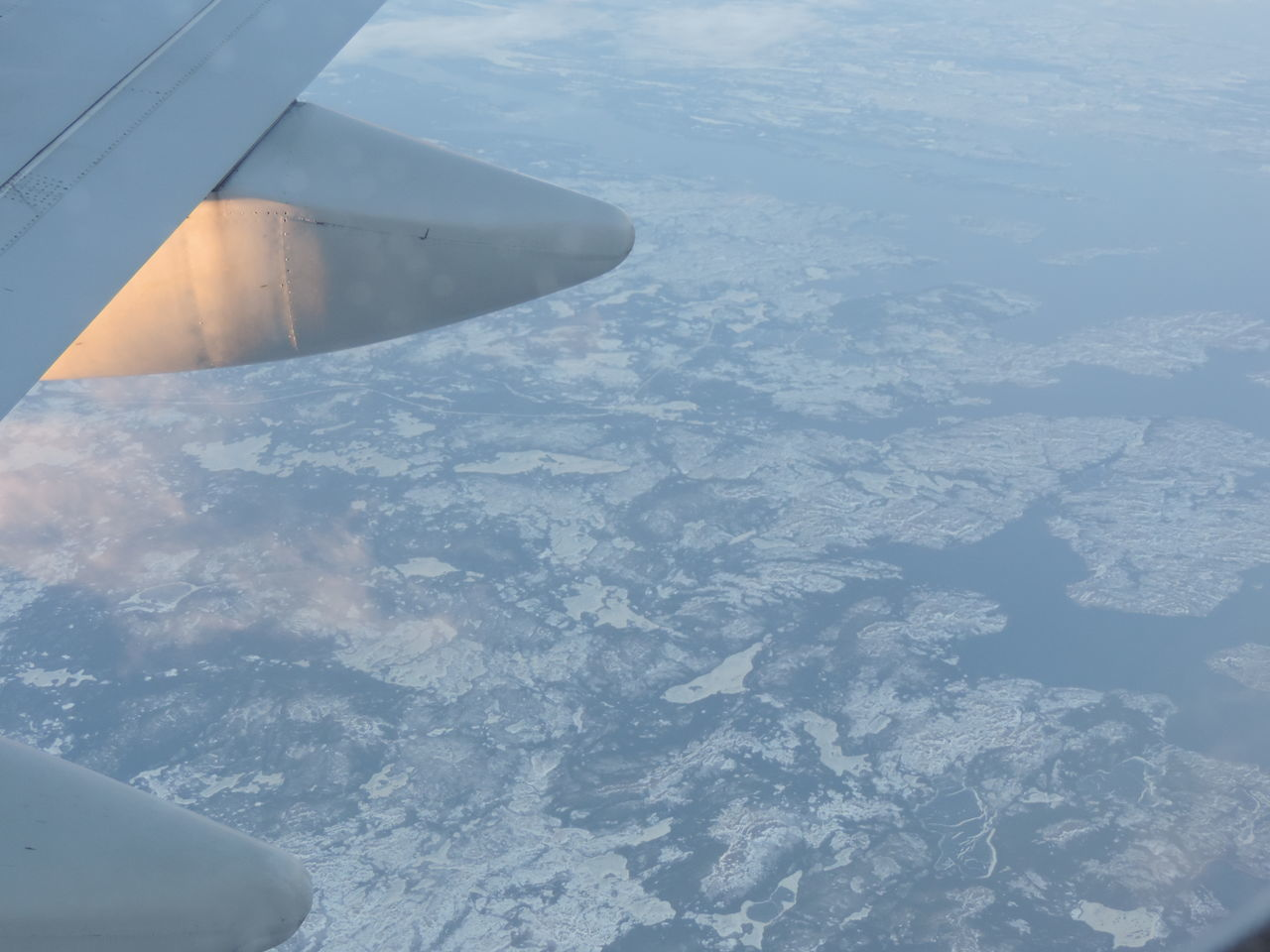 Looking down at the icebergs and icecaps near Greenland heading for JFK, NY 747 Aerial View Atlantic Ocean Boeing Icebergs Nature Scenics Sea Virgin Atlantic Wing View