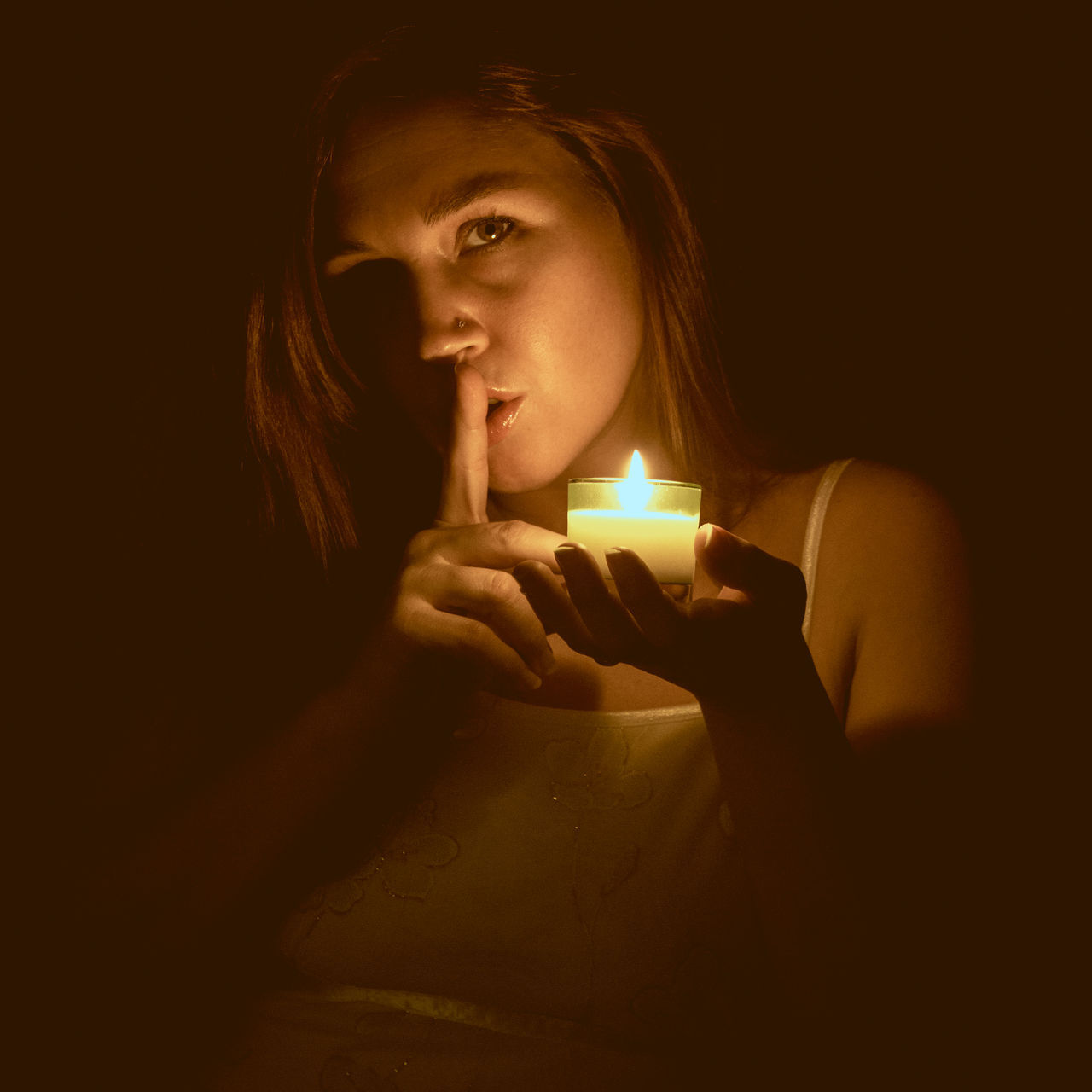 Black Background Candle Candle Light Dark Female Finger To Lips Flame Flowers Glowing Holding Candles Illuminated Looking At Camera Mysterious Night One Person Person Portrait Secretive Secrets Shhh Upper Body Woman