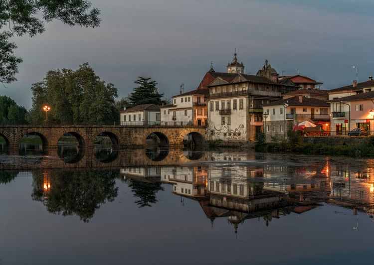 Blue hour caption of the old roman bridge in Chaves, Portugal Architecture Bridge Building Exterior Built Structure Chaves History No People Outdoors Portugal Reflection River Roman Bridge Travel Destinations Tree Water Waterfront Neighborhood Map