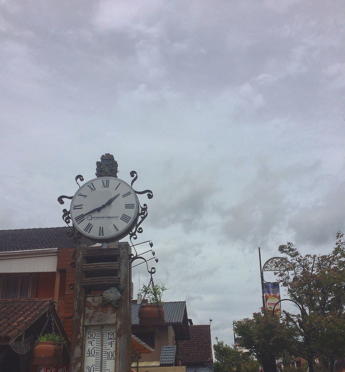 clock, time, architecture, built structure, building exterior, low angle view, sky, cloud - sky, day, clock face, no people, outdoors, city, minute hand, tree, hour hand, roman numeral