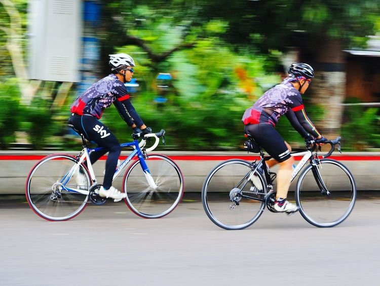 Road Bikers Bicycle Motion Road Bike Cycling Leisure Activity Sports Photography Sportbike Bicycle Transportation Land Vehicle Mode Of Transport Riding On The Move Cycling Leisure Activity Motion Lifestyles Travel Full Length Speed Blurred Motion Casual Clothing Helmet Cycling Helmet Men
