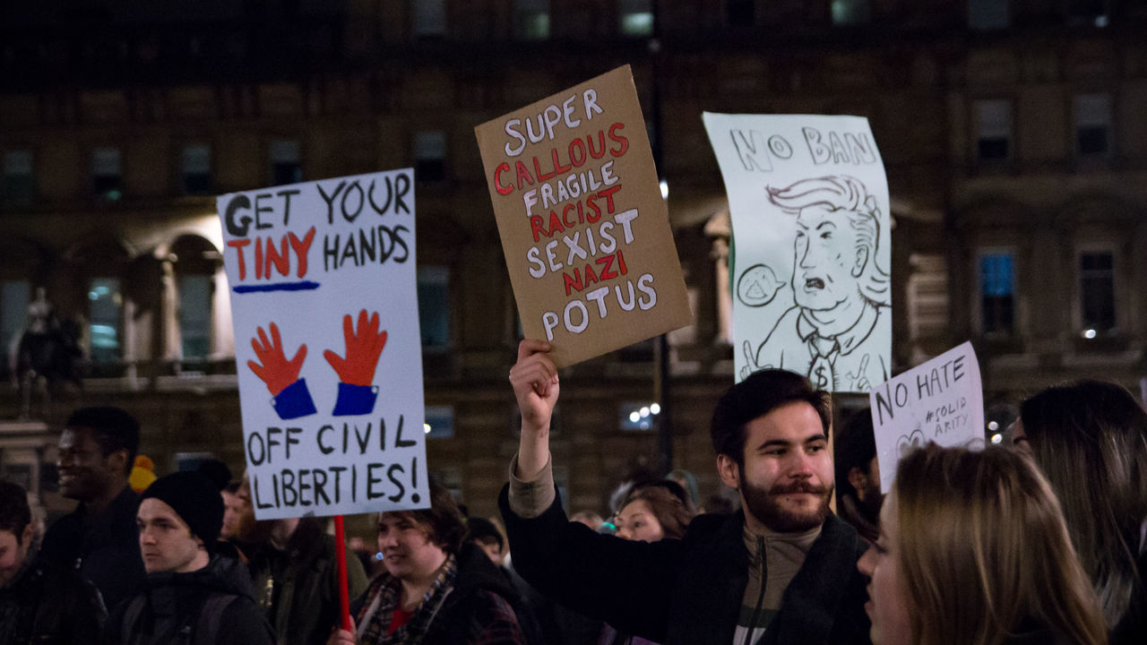 protest, text, protestor, banner - sign, women, communication, placard, crowd, men, anger, social issues, holding, patriotism, democracy, politics, real people, night, large group of people, building exterior, architecture, outdoors, city, adult, people