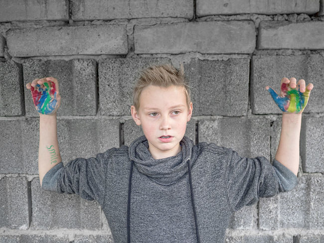 boy with coloured hands Boy Colour Coloured Coloured Hands Hope Innocence Life Goes On Problems Puberty Sad Sad Looking Child Solace Teenager Thinking Trouble