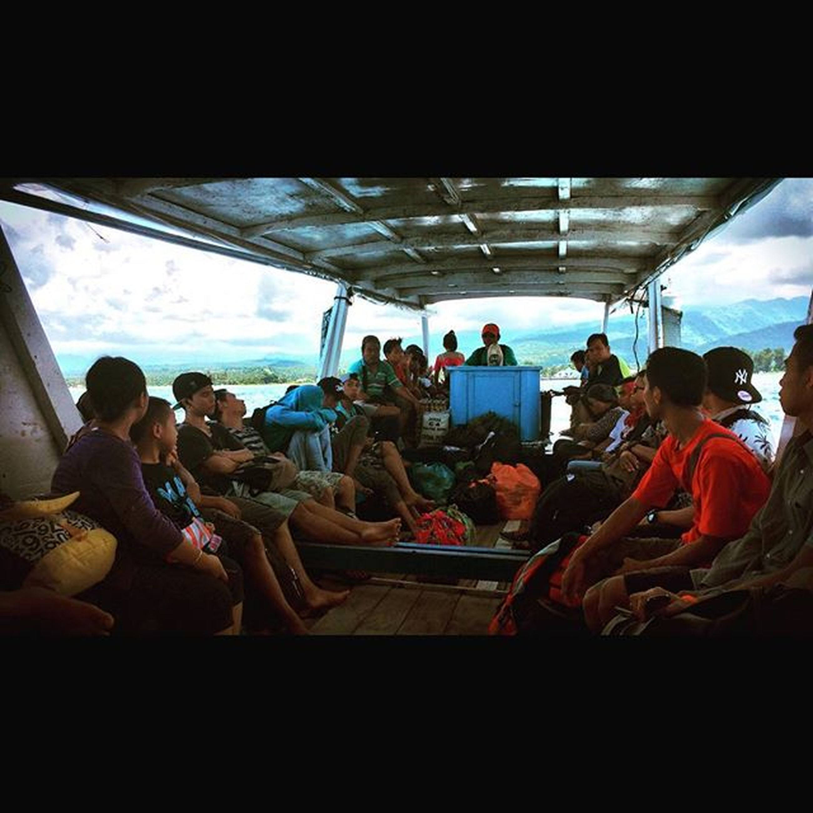 indoors, men, lifestyles, large group of people, person, leisure activity, medium group of people, transportation, travel, glass - material, sitting, standing, togetherness, journey, passenger, mixed age range, walking, window, public transportation