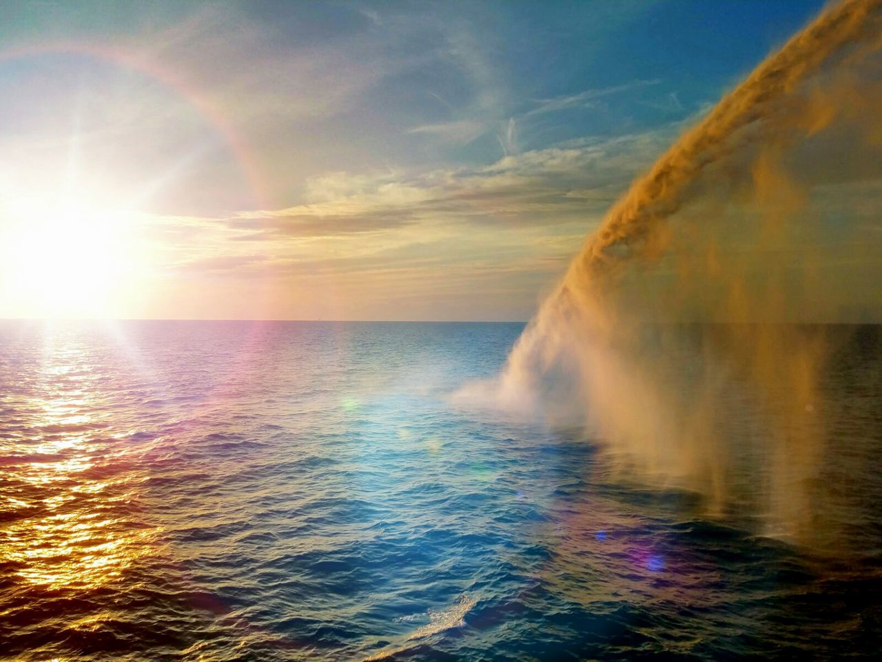 sea, water, horizon over water, nature, beauty in nature, scenics, sunset, sky, sunlight, no people, outdoors, motion, day