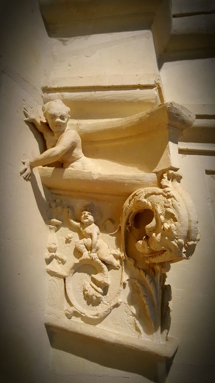 Low Angle View Of Gargoyle On Building Faade