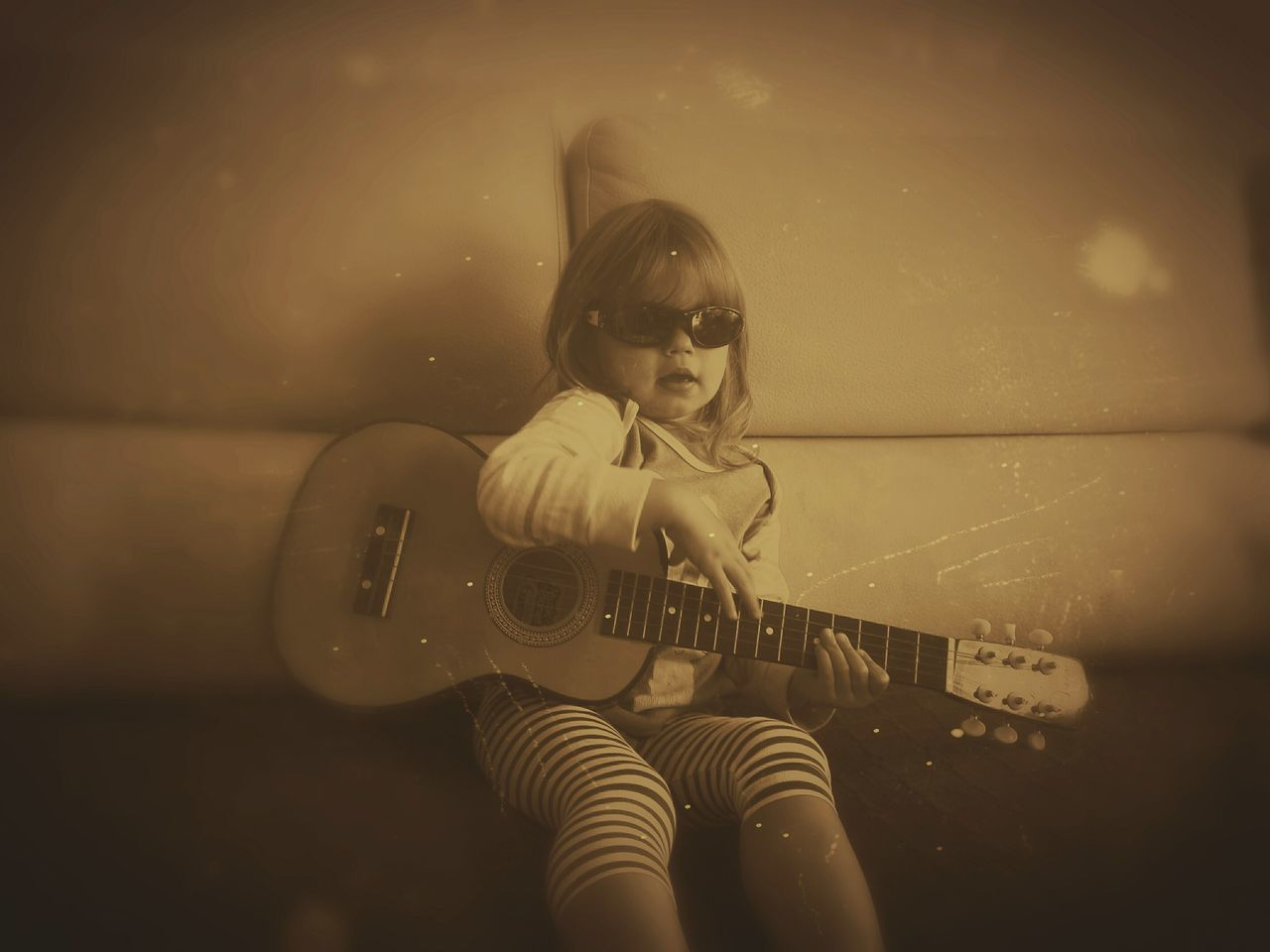 One Person Guitar B&W Photo Lifestyle The Portraitist - 2017 EyeEm Awards Learn & Shoot: Simplicity Monochrome Monochrome _ Collection Little Musician Blues Guitar Young Rocker Sepia Photography Sepia_collection Live For The Story Girl Imitation Playing Guitar!love It! Playing Guitar EyeEmNewHere