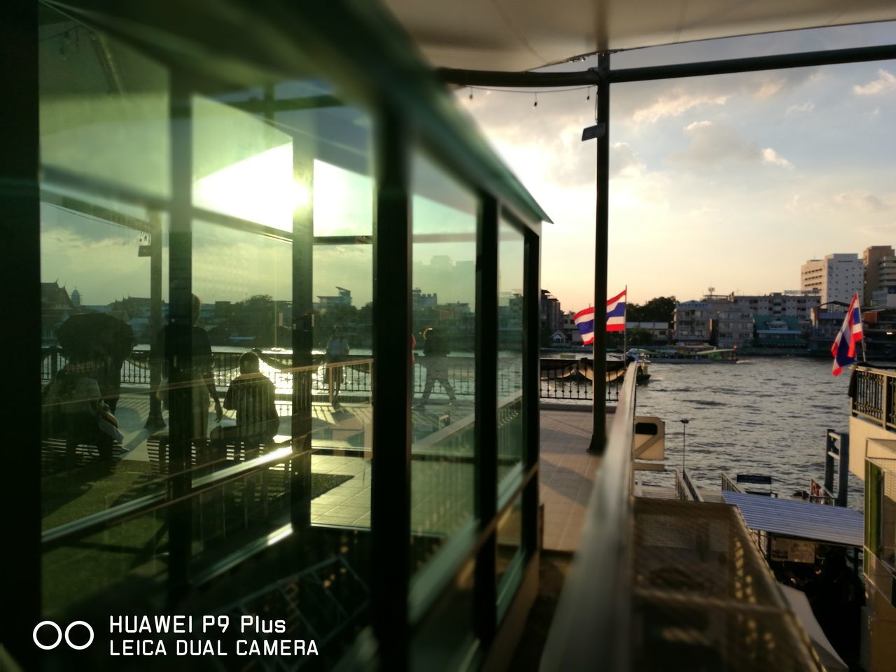window, reflection, architecture, transportation, water, mode of transport, travel, built structure, sky, building exterior, sunset, day, city, indoors, no people, nature, close-up
