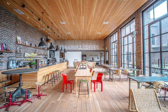 Coffee JEJU ISLAND  TERAROSA Indoors  Chair Empty Absence Table Group Of Objects Education Ceiling Arrangement In A Row Large Group Of Objects Library Abundance Aisle Hanging Light Place Setting Pew Order Red No People