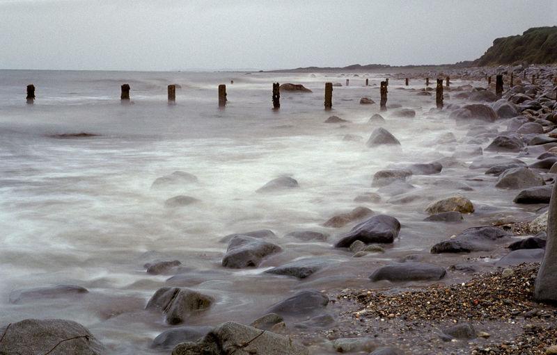 grain: long exposure of a north wales beach Beach Boulders Ccrieth Cliff Cliffs Coastline Criccieth Groynes Long Exposure Mist Misty Rocks Scenics Sea Shore Stone Stones Surf Water Wave Waves