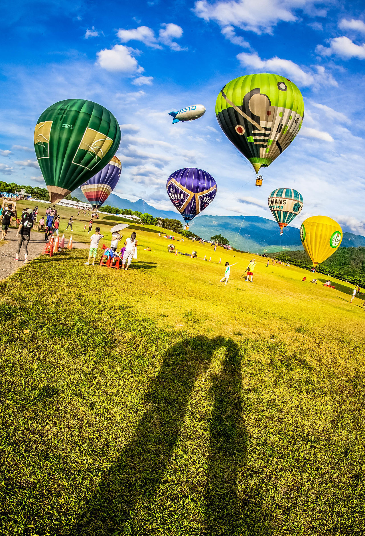 Ballooning Festival Cloud - Sky Couple Day Grass Hot Air Balloon Large Group Of People Leisure Activity Multi Colored Outdoors People Recreational Pursuit Sky Travel Destinations