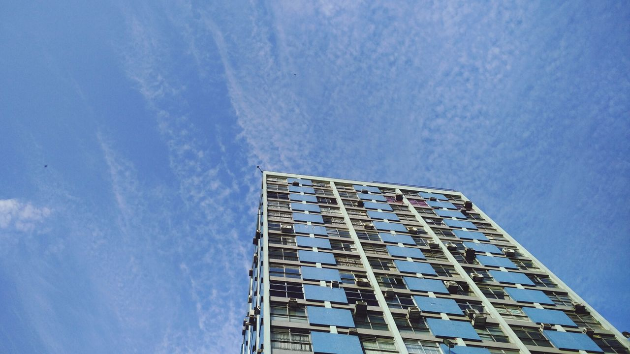 low angle view, architecture, building exterior, built structure, day, sky, blue, window, no people, outdoors, modern
