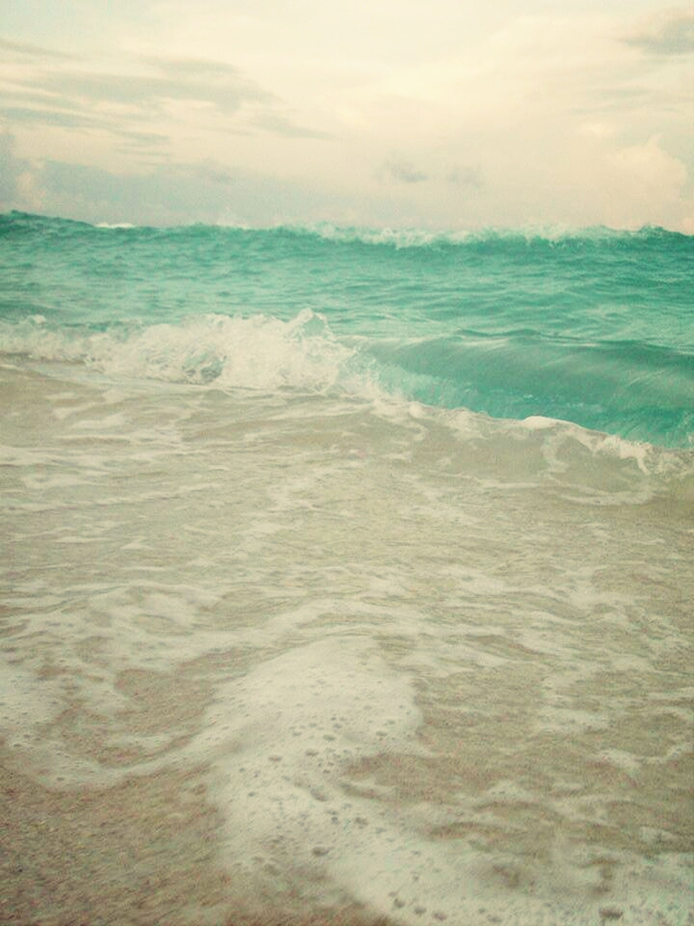 sea, water, horizon over water, wave, beach, scenics, beauty in nature, sky, surf, tranquil scene, shore, tranquility, nature, motion, cloud - sky, idyllic, sand, seascape, waterfront, day