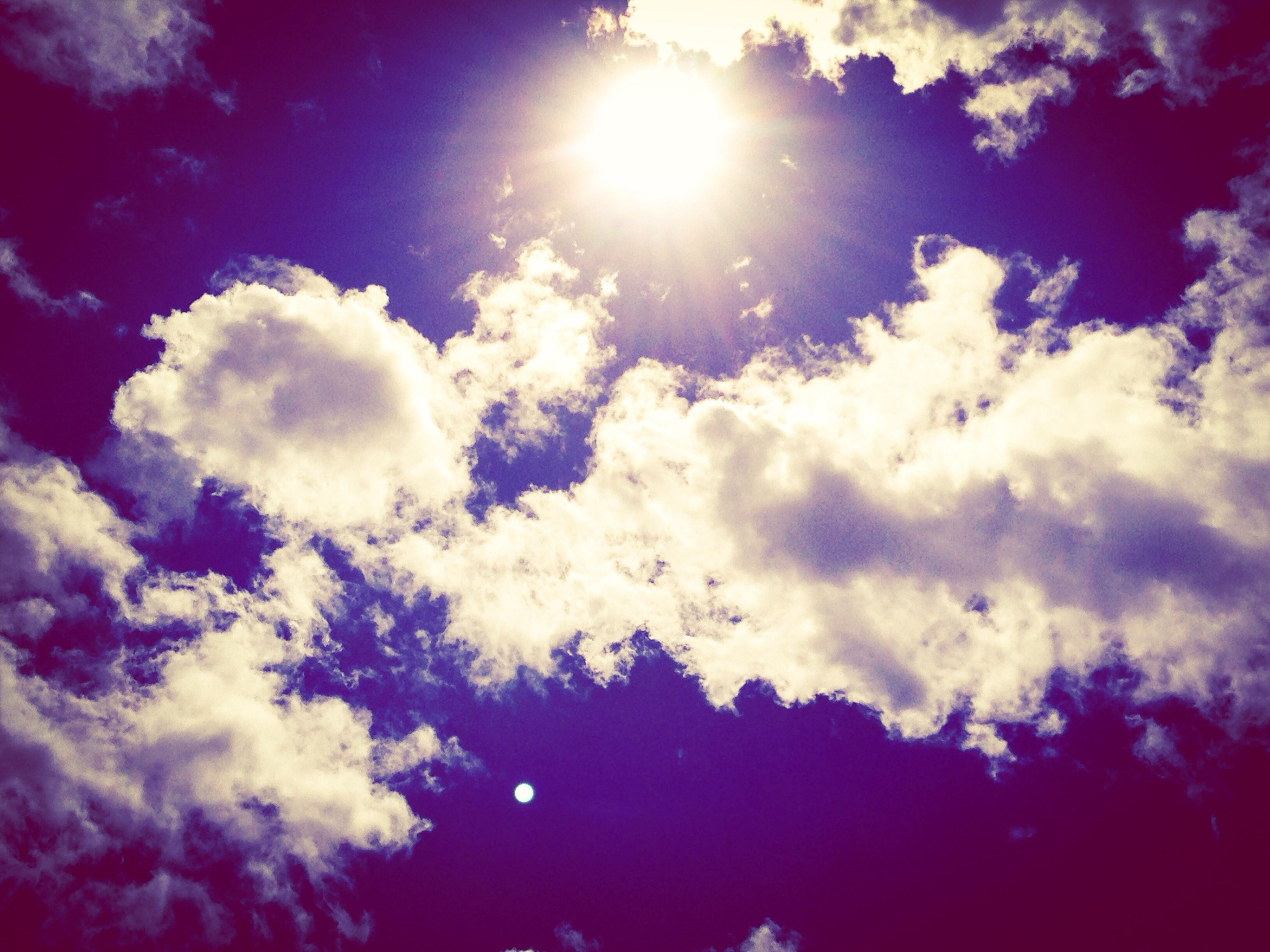 sun, sky, sunbeam, cloud - sky, low angle view, sunlight, beauty in nature, tranquility, nature, scenics, tranquil scene, lens flare, cloudy, cloud, bright, cloudscape, sky only, sunny, silhouette, weather