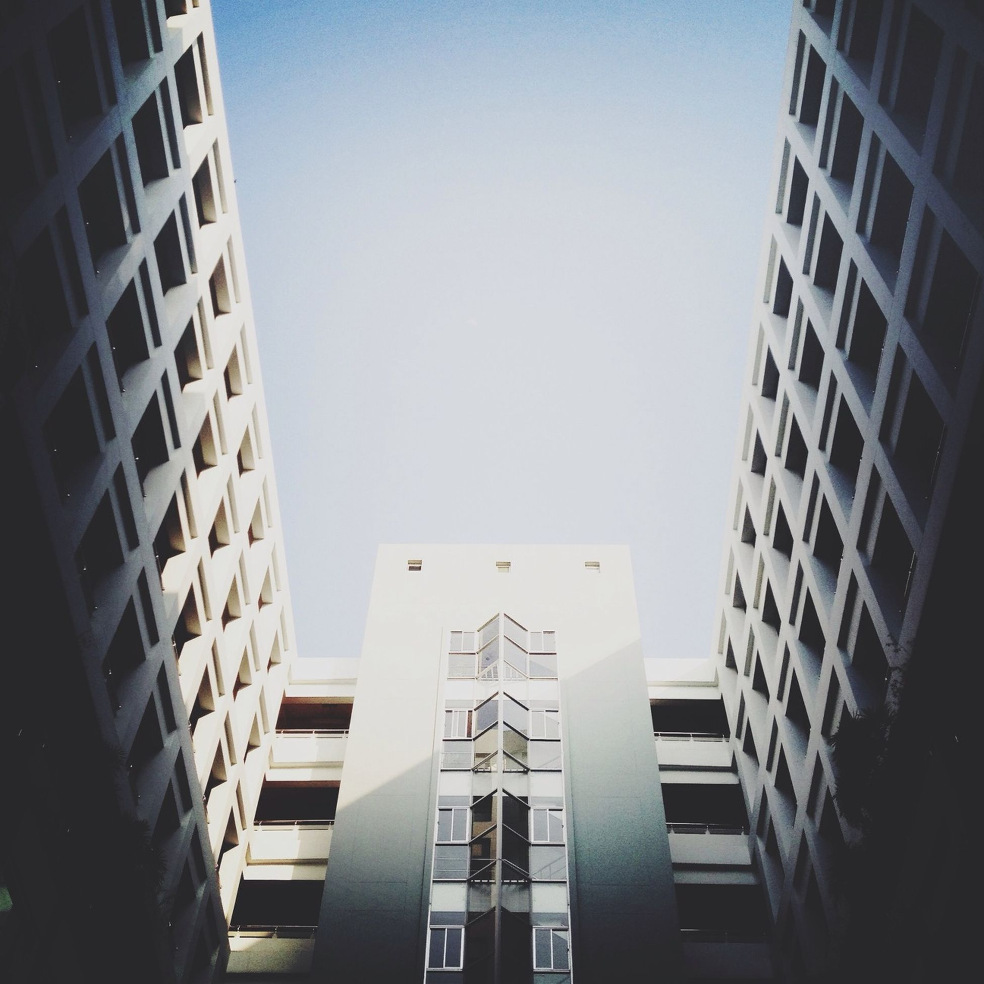 architecture, building exterior, building, window, residential structure, built structure, city, office building, residential building, modern, balcony, apartment, facade, low angle view, city life, fish-eye lens, perspective, composition, modern, exterior, urban, development, city life