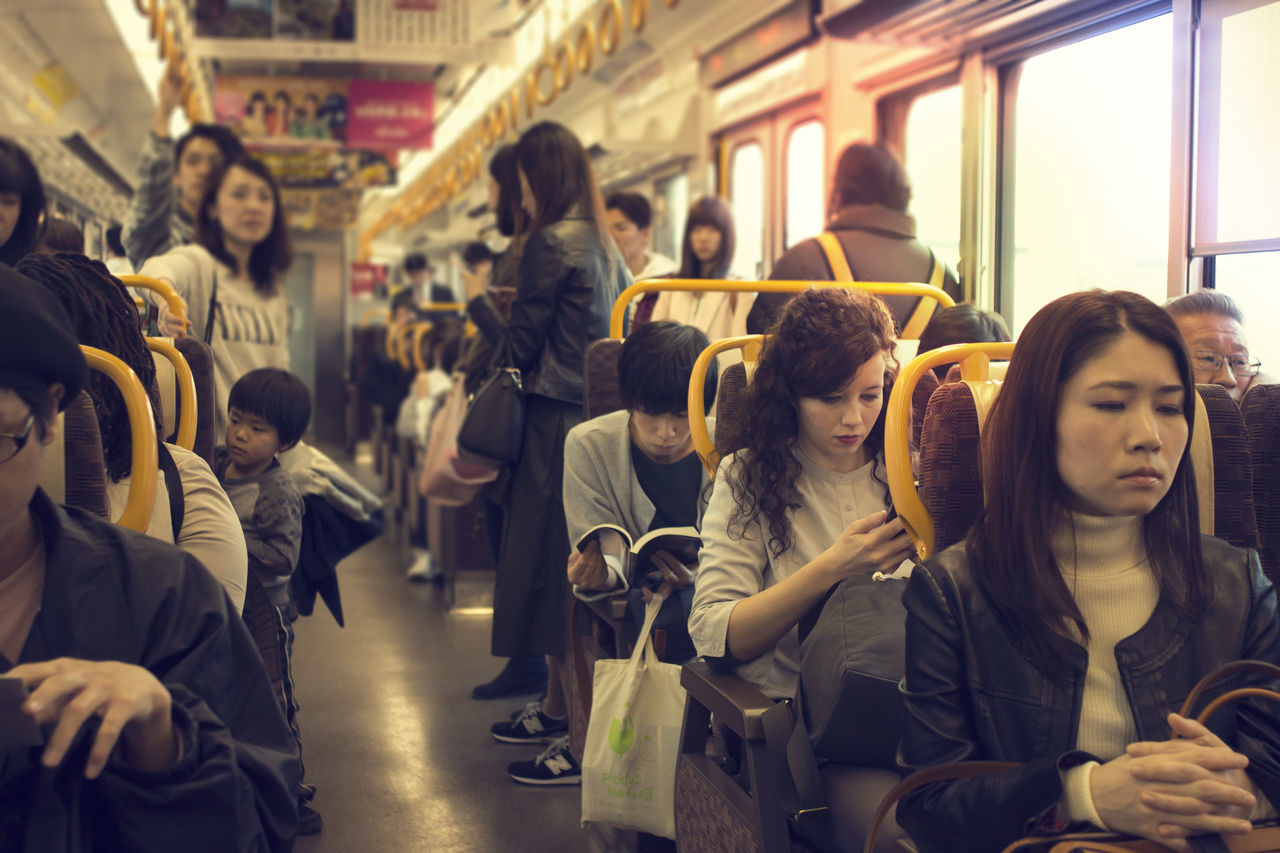 ASIA Beautiful Beauty Casual Clothing Crowd Day Everyday Girl Indoors  Japan Kyoto Large Group Of People People Public Transportation Reading Real People Sitting Smartphone Subway Subway Train Tokyo Train - Vehicle Trainride Women Young Adult