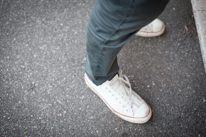 All Star Shoes Asphalt Casual Clothing Close-up Day Footwear Ground Jeans Leisure Activity Lifestyles Low Section Outdoors Part Of Person Personal Perspective Road Sneakers Street Urban Clothing