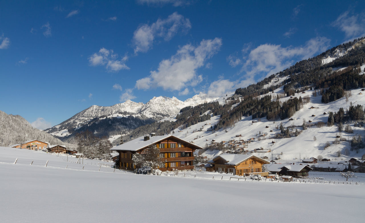 Winter in Lenk im Simmental, Switzerland Architecture Beauty In Nature Blue Building Exterior Built Structure Chalet Cloud - Sky Cold Temperature House Landscape Mountain Mountain Range No People Outdoors Residential Building Rural Scene Scenics Sky Snow Tranquil Scene Vacations White Color Winter