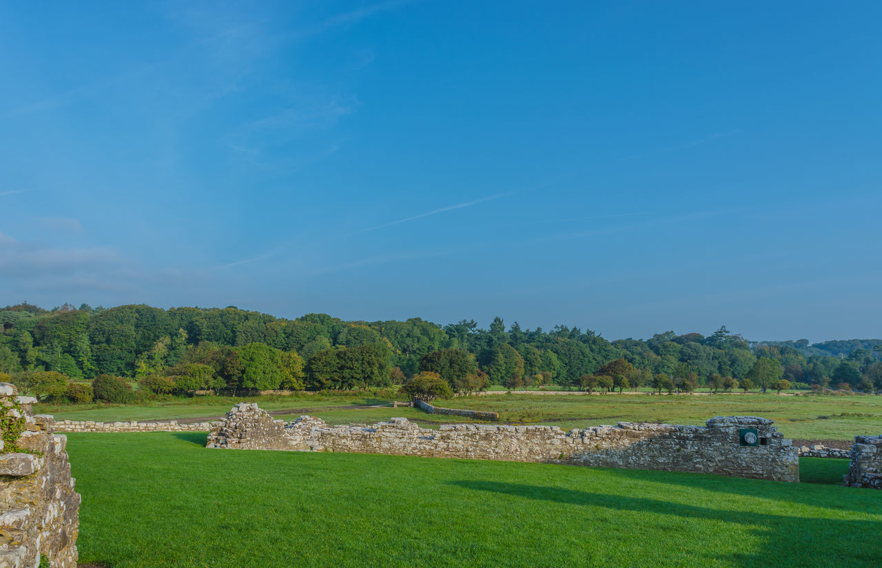 Stone Wall On Field Against Sky At Ogmore Castle