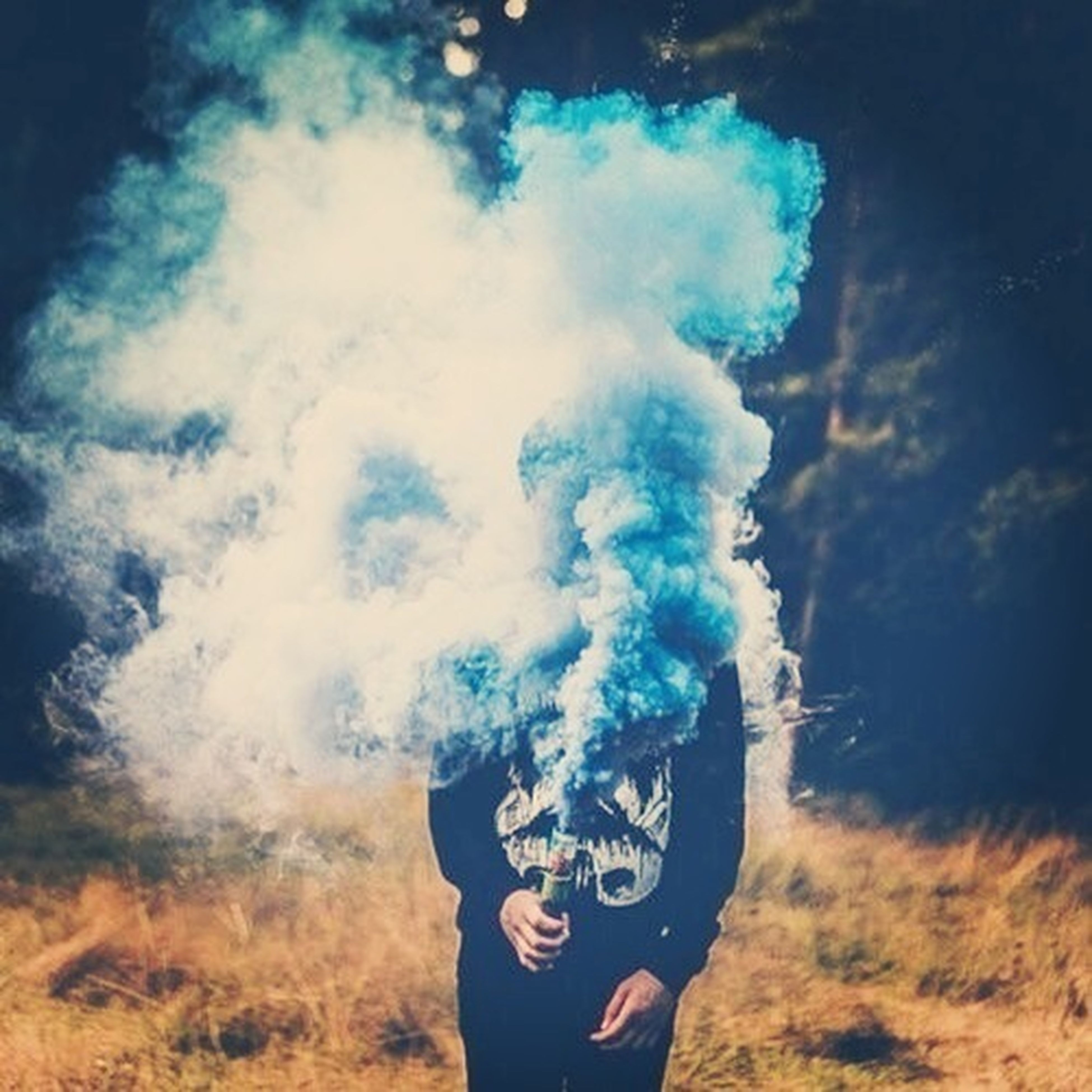 leisure activity, lifestyles, sky, cloud - sky, standing, blue, men, waist up, cloudy, casual clothing, unrecognizable person, cloud, three quarter length, headshot, outdoors, day, holding, smoke - physical structure