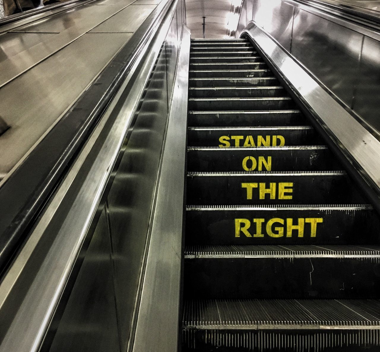 text, communication, technology, indoors, staircase, steps, transportation, steps and staircases, illuminated, subway station, convenience, no people, day