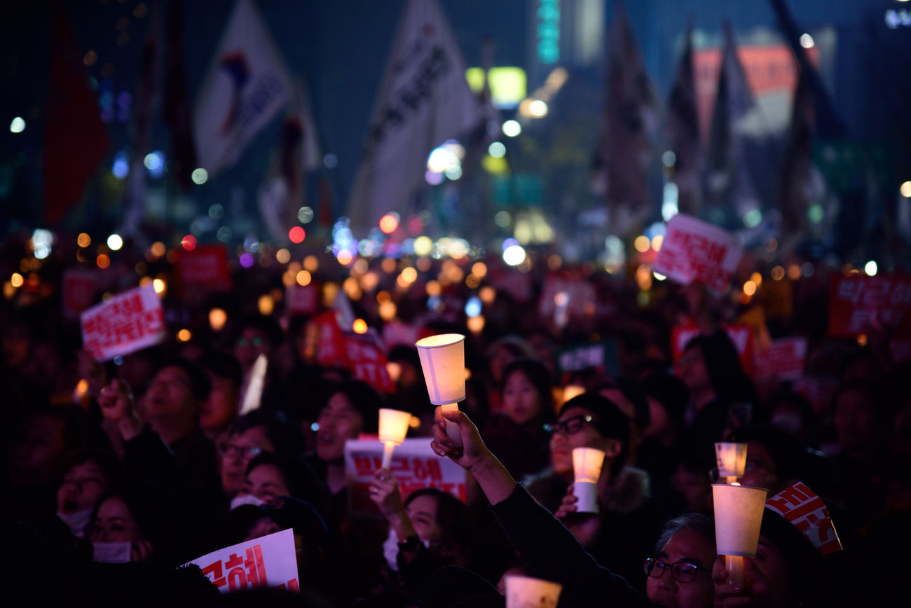 Koreans try to cure the democracy in Korea Communication Crowd For Korean Democracy Human Hand Illuminated Large Group Of People Night Outdoors People Photo Messaging Real People Smart Phone Technology Wireless Technology