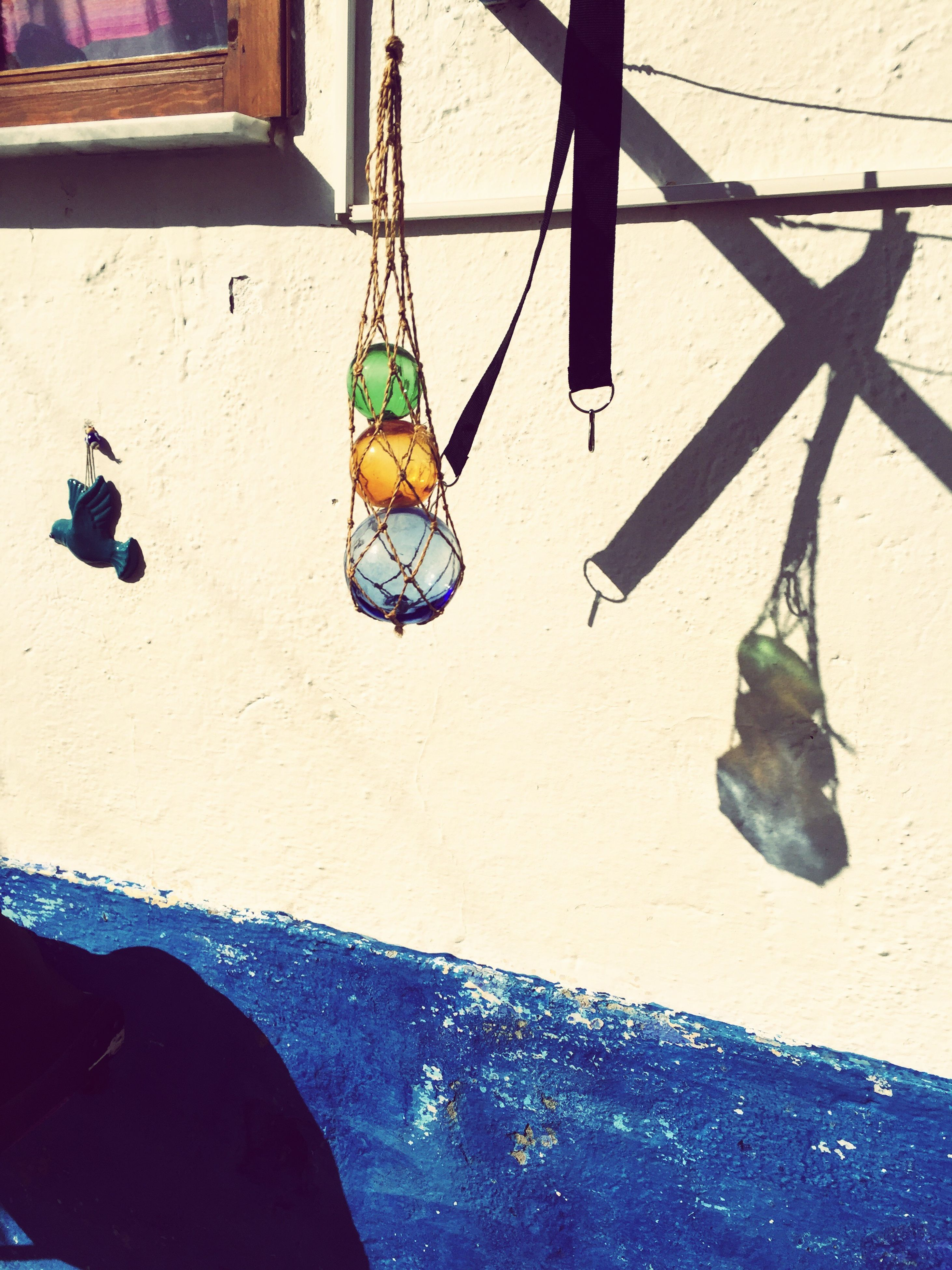 hanging, day, outdoors, multi colored, no people