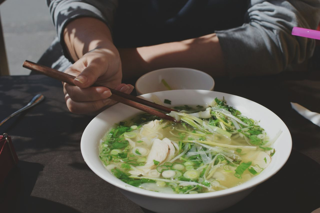 Up Close Street Photography Lunch break. Soup Bowl Of Soup Vietnamese Food Lunch Break Food Food Porn Eating Eating Healthy Eating With Friends Chopsticks Sharing Is Caring Yummy Vegetables Hands In Action Fine Art Photography Capture Berlin Adapted To The City