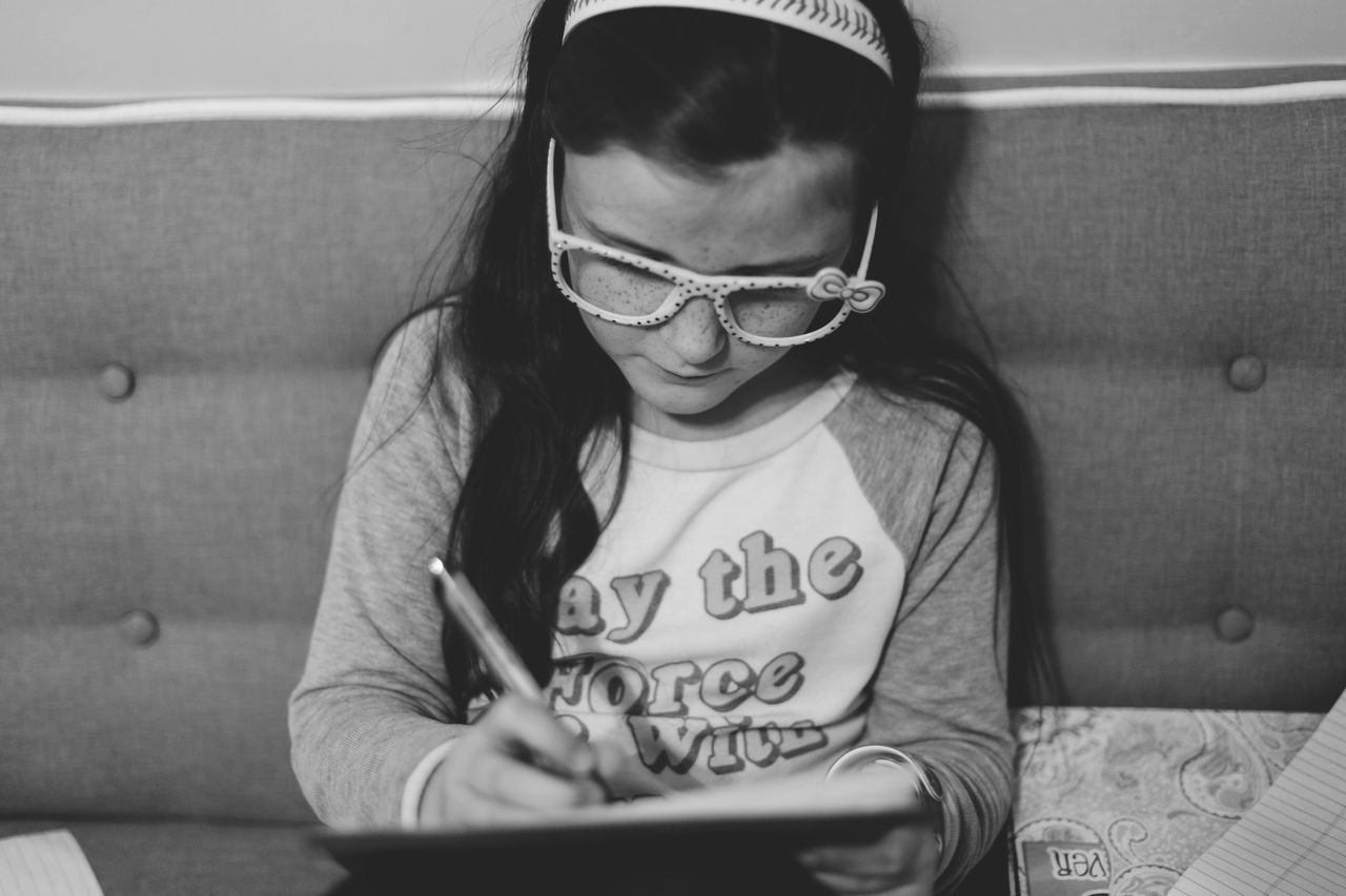 Childhood Drawing - Activity Girl In Glasses Glasses Home Interior Indoors  Leisure Activity Lifestyles One Person Real People Sitting Sunglasses