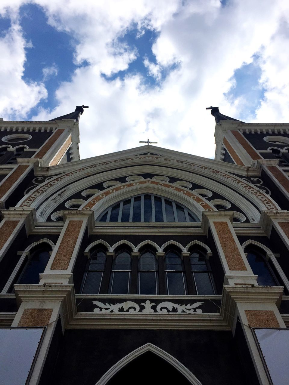 low angle view, architecture, sky, cloud - sky, built structure, building exterior, outdoors, history, day, facade, no people