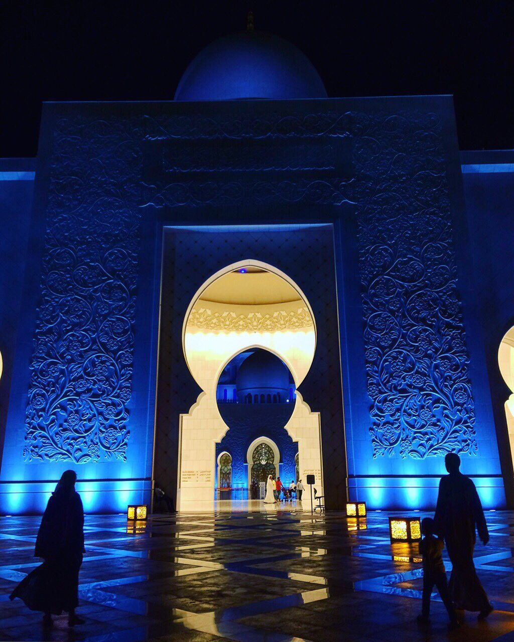 spirituality, religion, illuminated, night, place of worship, arch, built structure, real people, rear view, walking, full length, architecture, travel destinations, two people, travel, indoors, lifestyles, women, people, adult