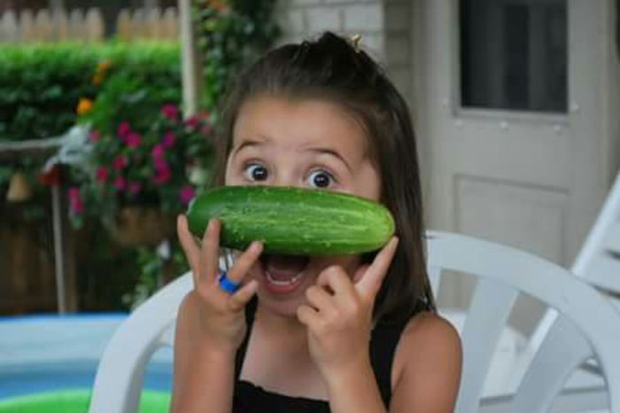 Hanging Out Check This Out Hello World Cucumber Eyem Hi! Taking Photos That's Me Cheese! Enjoying Life Washington, D. C. Eyemphotos Eyem Kids Eyem Gallery Portraits Of EyeEm Eyem Children Portrait Eyembestshots Silly Face Kids Portrait Vegetables Photos Cucumbers Gardening Kids And Nature Kids And Food