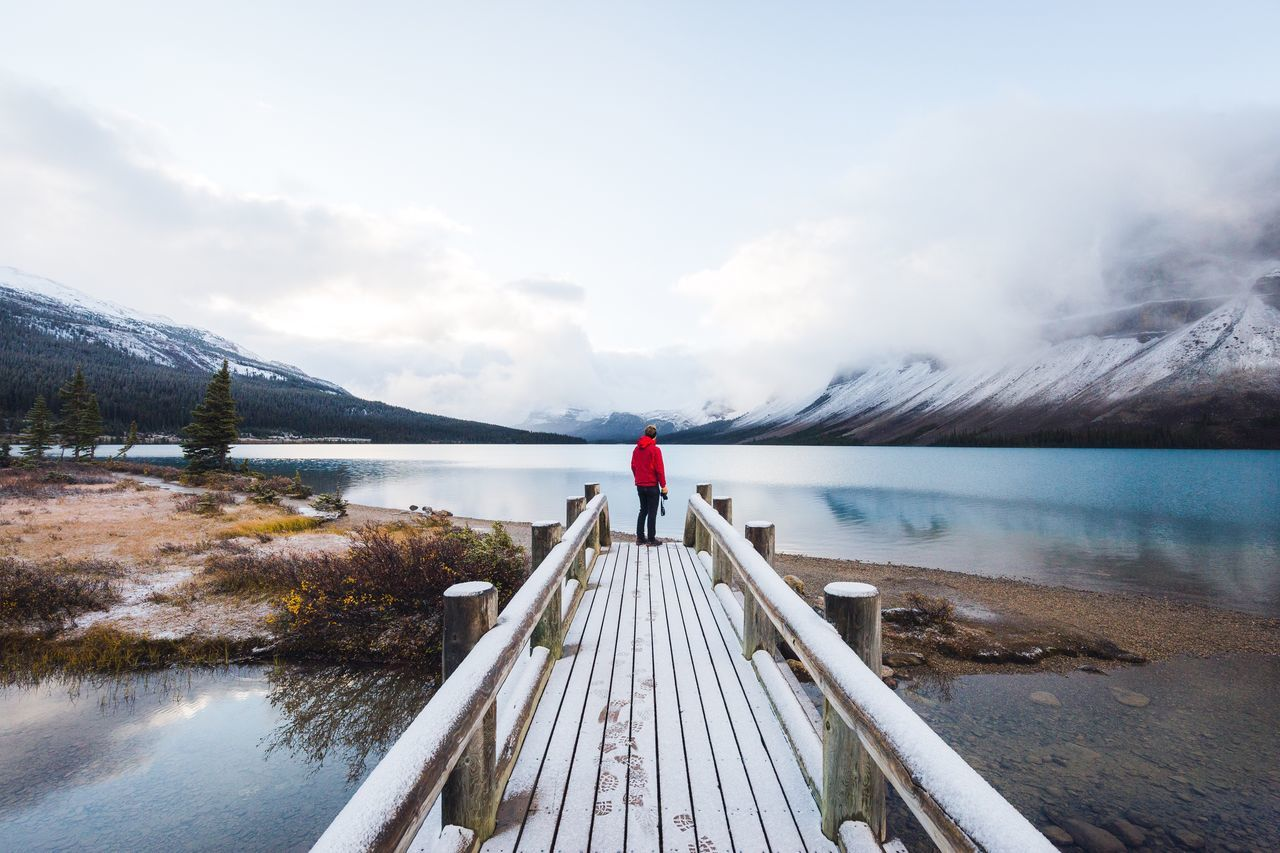 First sights of winter at Bow Lake. Canada Water Nature Jetty Pier Beauty In Nature Lake Sky Cloud - Sky Rear View One Person Wood - Material Tranquil Scene Tranquility Scenics Full Length Day Outdoors Standing Young Adult Adults Only