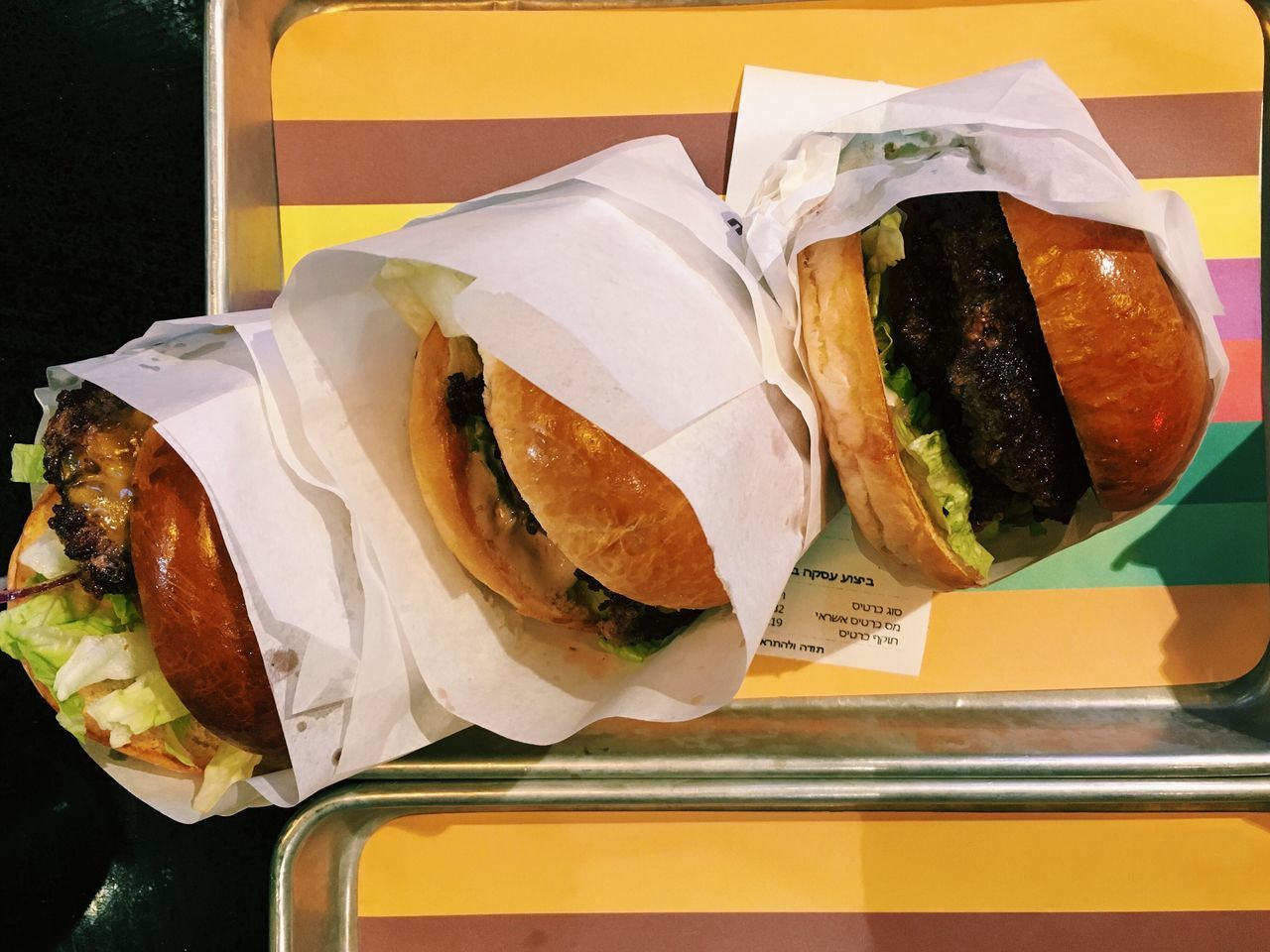 High Angle View Of Burgers In Tray