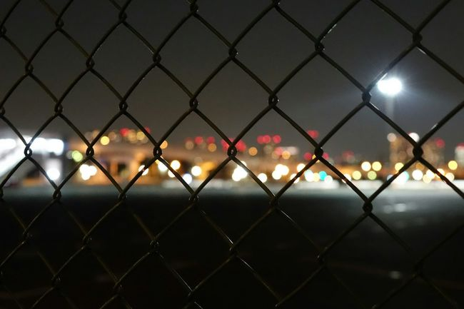 Japan Photos Wire Mesh Night Lights Mesh Wire Fence Light And Shadow From My Point Of View Nightshot Street Photography Night Photography Night View Streamzoofamily The Street Photographer - 2016 EyeEm Awards Ultimate Japan
