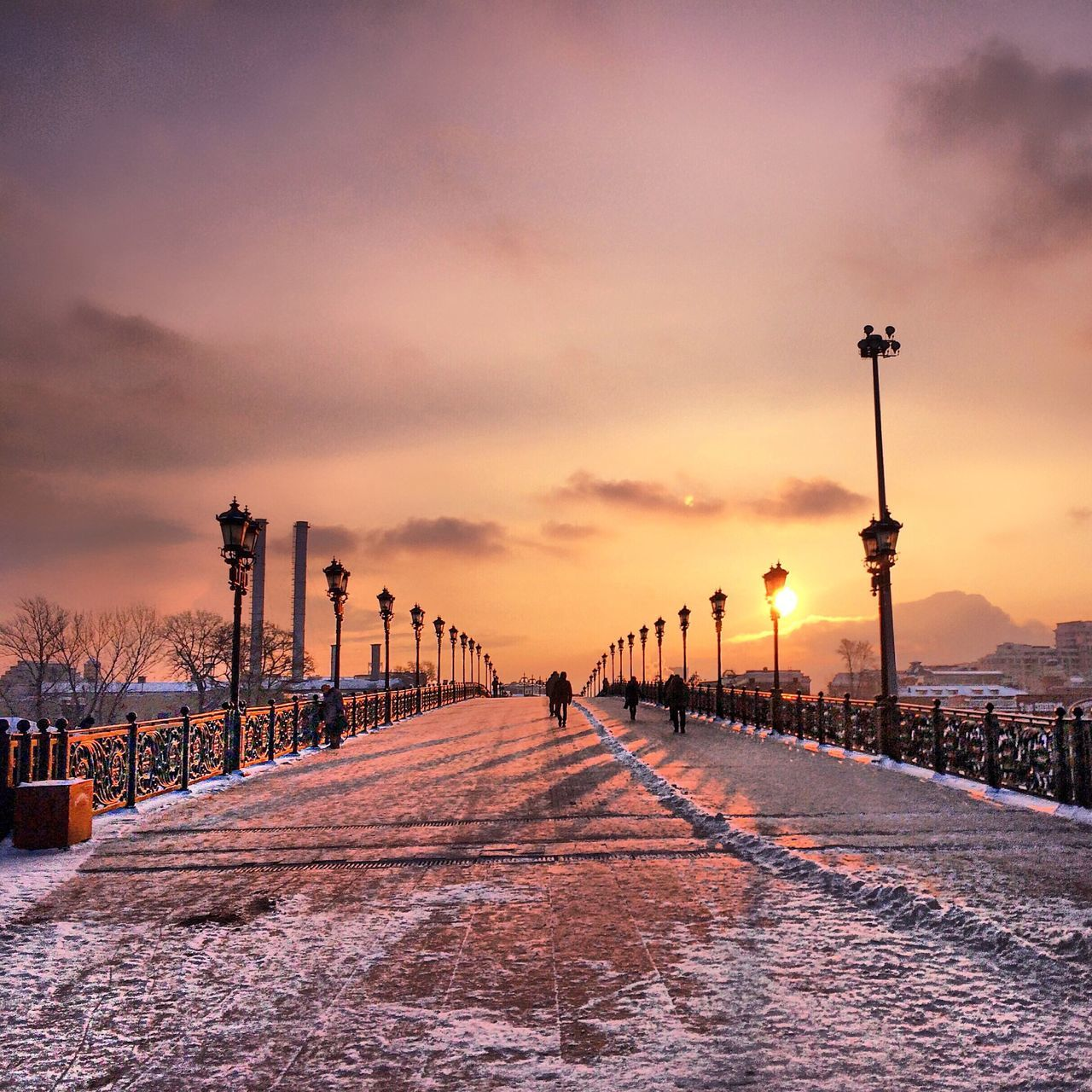 Snowy Patriarchal Bridge Against Sky During Sunset