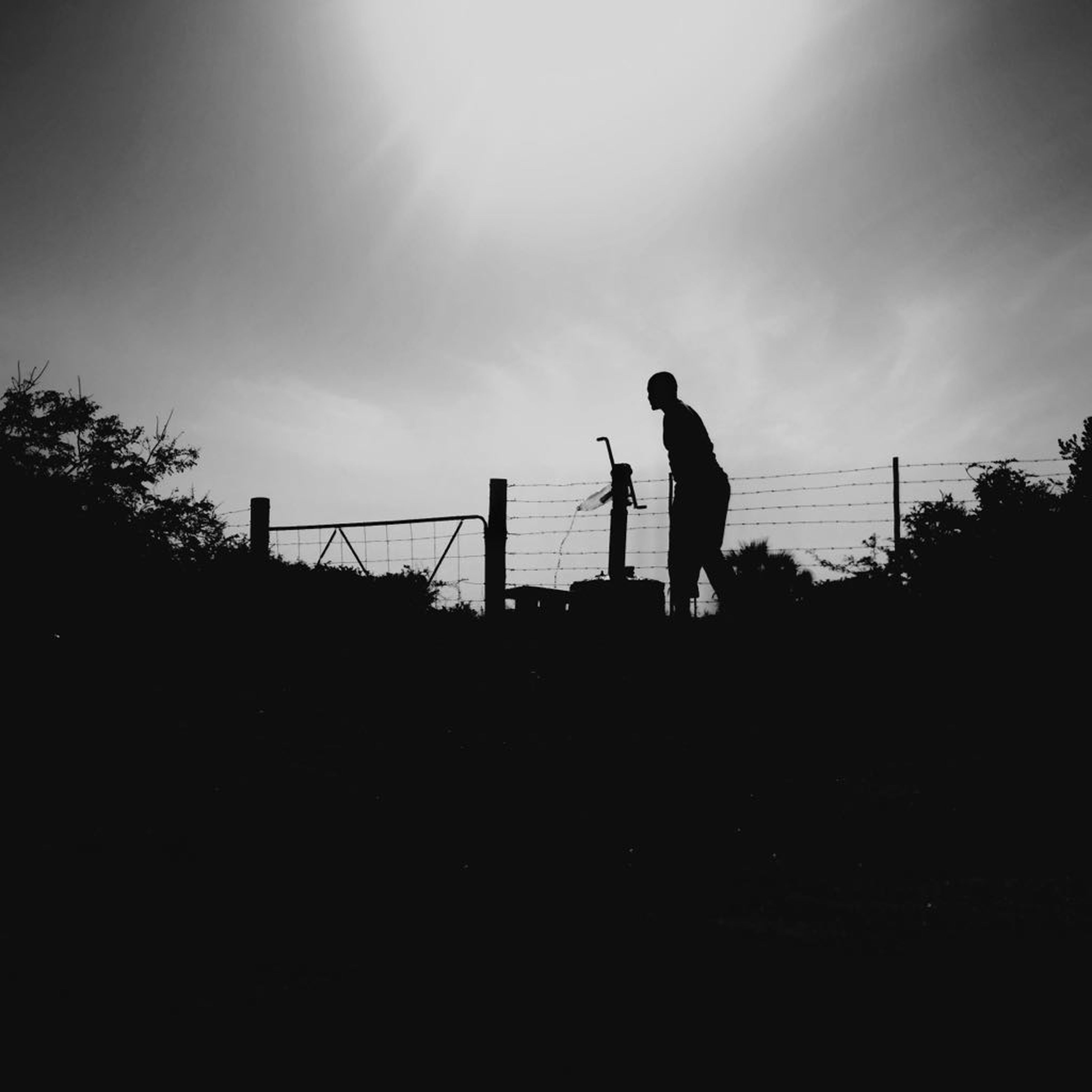 silhouette, real people, leisure activity, lifestyles, two people, standing, sky, men, outdoors, nature, full length, friendship, day, adult, people