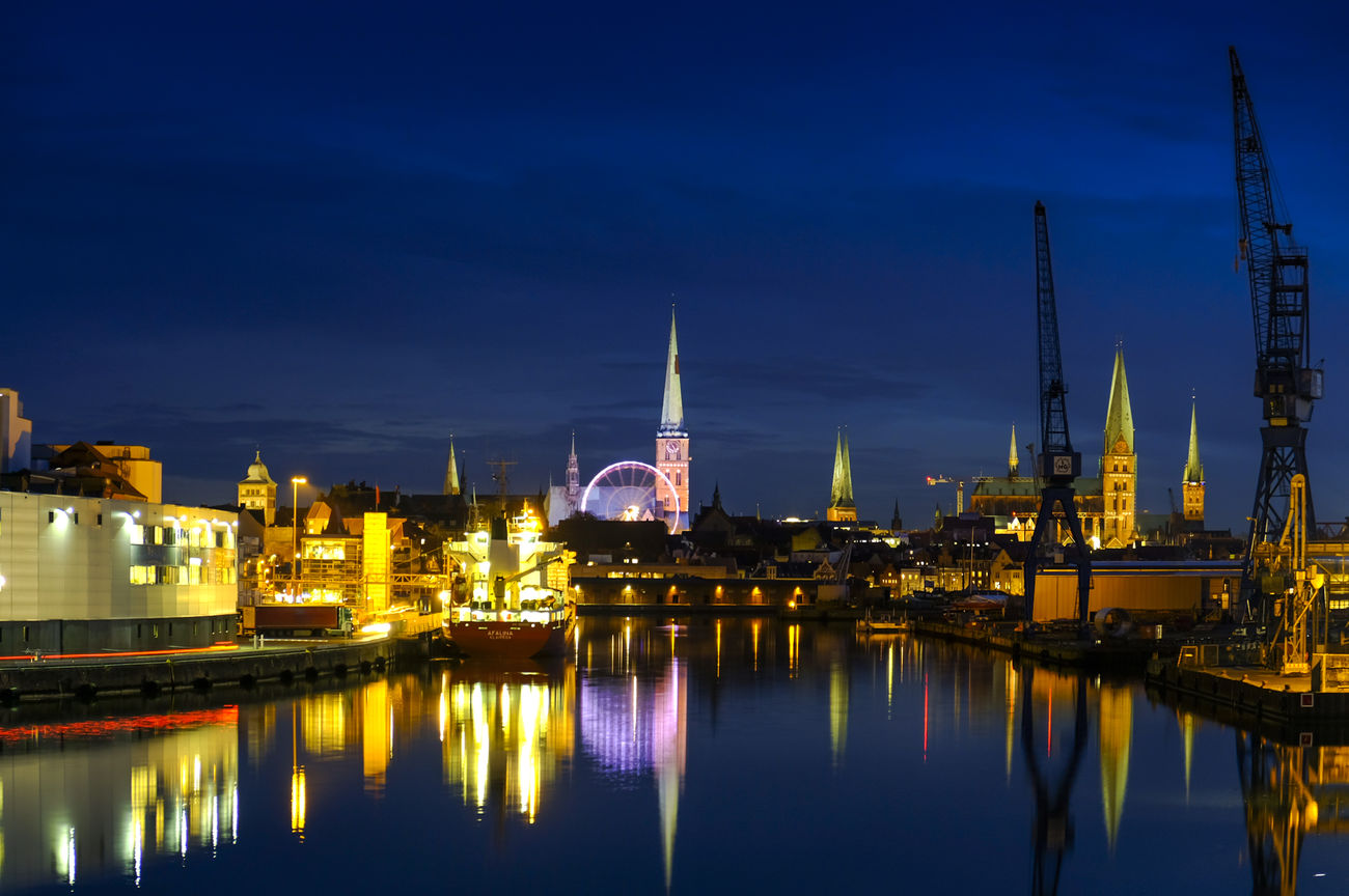 A calm evening in my town and the christmas season has begun Architecture Built Structure Cathedral City City Life Cityscape Crane Embrace Urban Life Ferriswheel Fresh On Eyeem  FUJIFILM X-T2 Harbour Illuminated Lübeck Night Panorama Reflection Riesenrad Tower Travel Destinations Urban Urban Skyline Water My Year My View Weinachtsmarkt