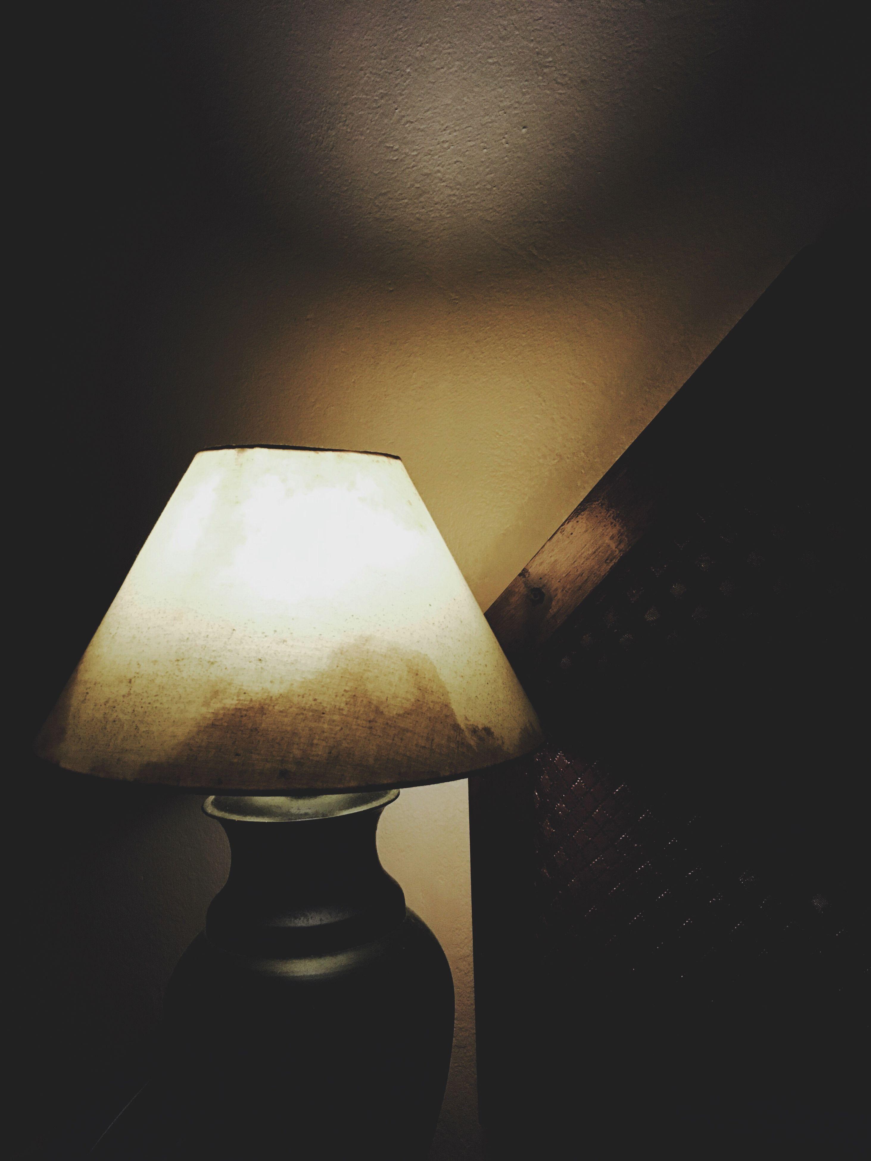 indoors, close-up, still life, single object, wall - building feature, copy space, illuminated, lighting equipment, no people, studio shot, home interior, dark, metal, black background, shadow, darkroom, light - natural phenomenon, shape, night, art and craft