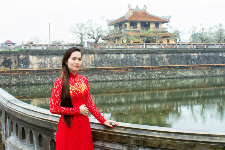 Only Women One Person Bridge - Man Made Structure Adult People Young Women Lake Red Lifestyles Architecture Young Adult Building Exterior Travel Destinations Adults Only Outdoors Water Smiling Beauty One Woman Only Portrait