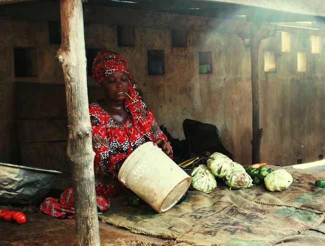 Woman selling cabbages old Tamale's market Africa First Eyeem Photo Ghana Black Magic Woman African Market Beautiful Dress  Tipical Dress Cabbages Selling Eating Cabbage Trip Photo Bucket Dirty Place Coloured Stick Eating Woman In Red Urban Africa Vegetables BYOPaper! Life African Village Lostplacephotography Another World Pureness Reality The Street Photographer - 2017 EyeEm Awards EyeEm Selects
