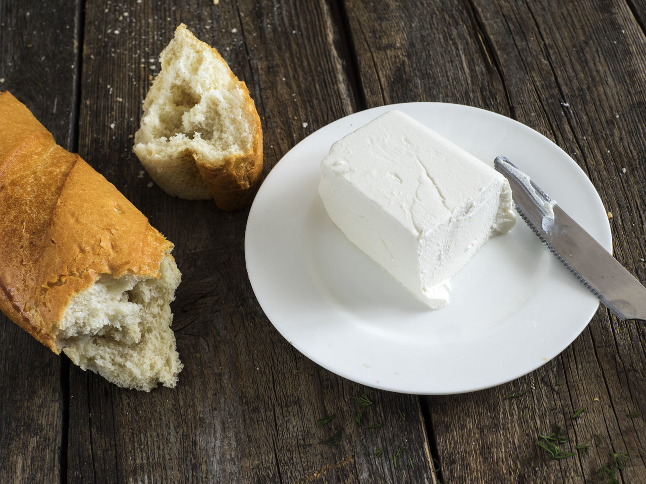 ingredients for cooking: bread and feta on an old wooden weathered table Bread Cheese Close-up Cooking Day Feta Food Food And Drink French Food Freshness Indoors  Ingredients No People Old Plate Sweet Food Table Weathered Wood - Material Wooden