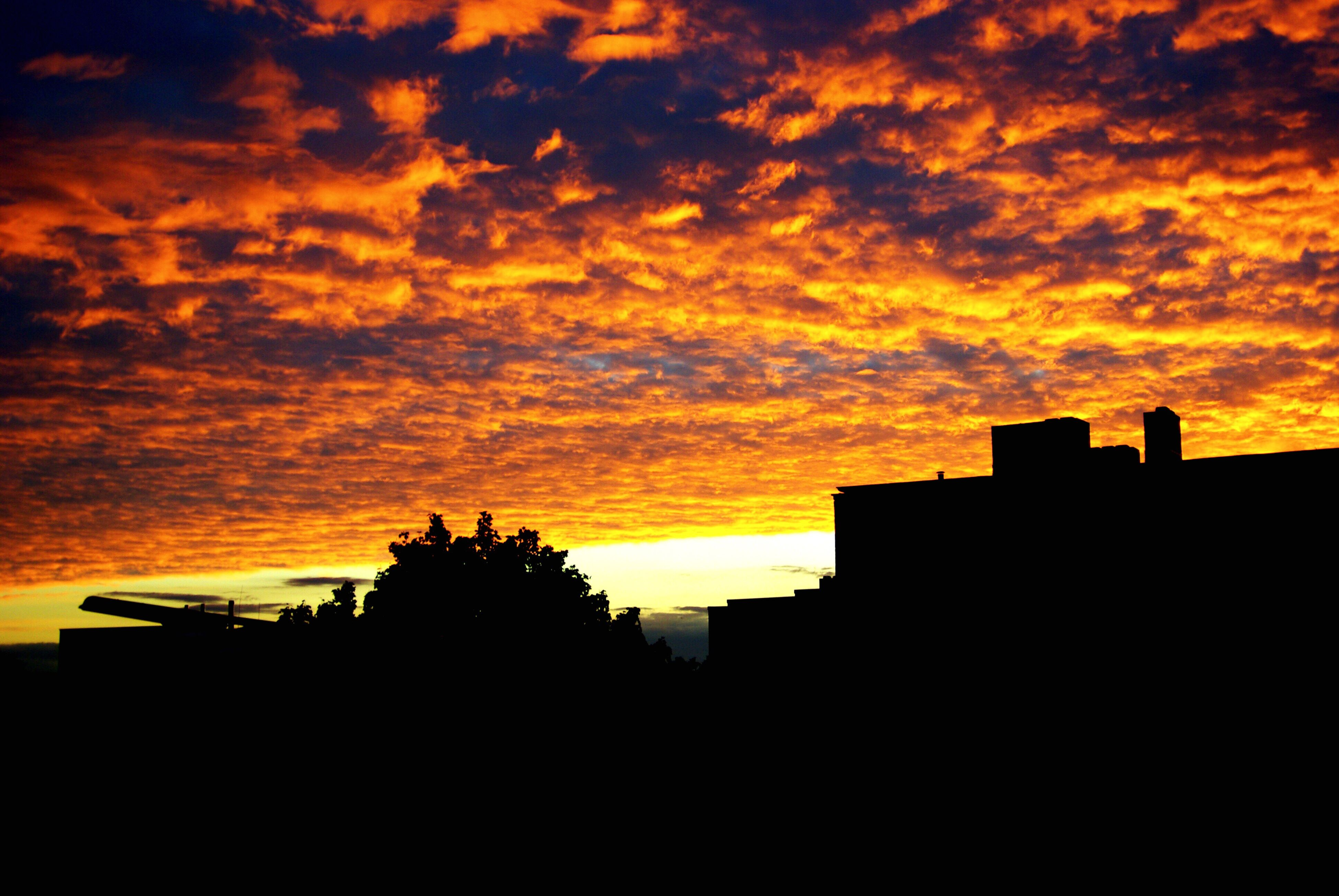 silhouette, sunset, architecture, built structure, building exterior, cloud - sky, orange color, sky, city, cloudy, scenics, outdoors, nature, beauty in nature, outline, no people, majestic, dramatic sky