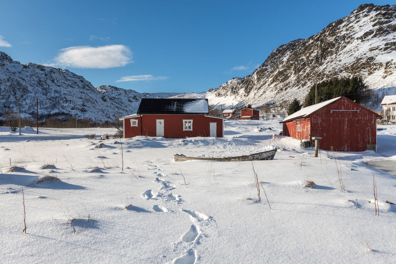 Architecture Beauty In Nature Blue Sky Built Structure Cold Temperature Day Deep Snow Houses Landscape Lofoten Mountain Mountain Range Nature No People Norway Outdoors Scenics Sky Snow Traces Traces In The Snow Weather White Color Winter