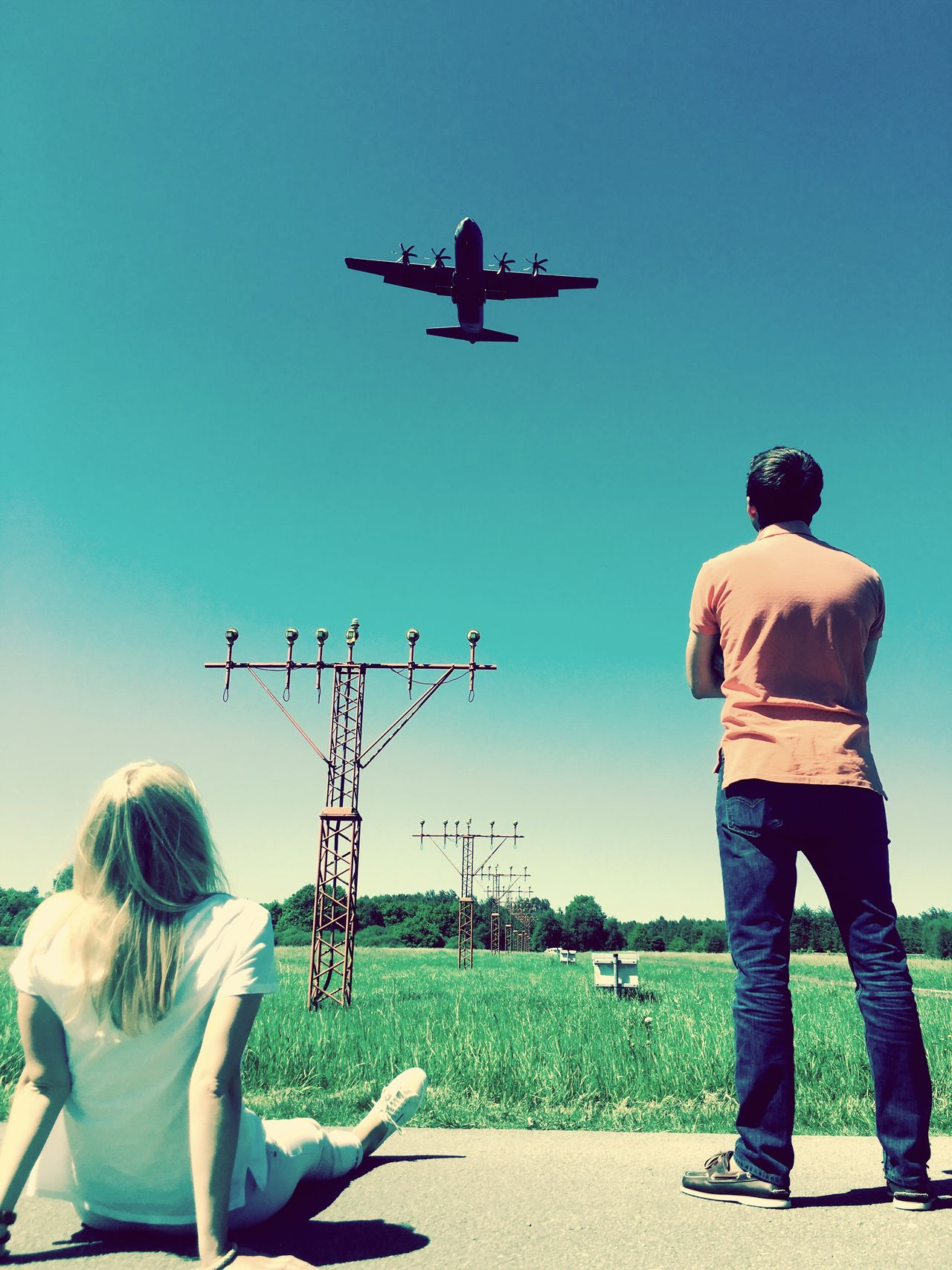 Real People Rear View Day Clear Sky Casual Clothing Leisure Activity Watching Outdoors Technology Sky Lifestyles Standing Men Togetherness Full Length Flying Childhood Airplane Nature People Airport Aircraft C113 AirPlane ✈